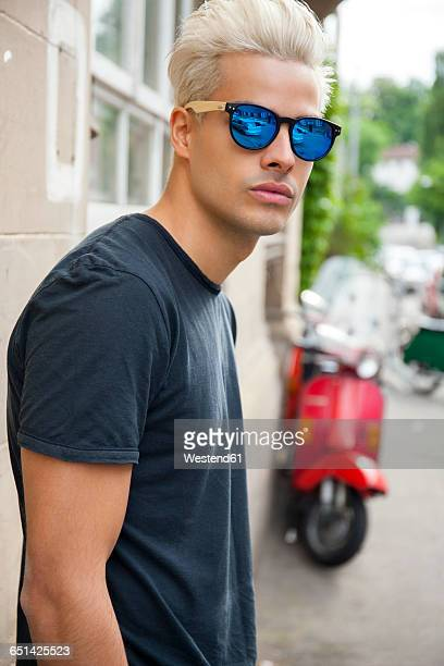 Portrait of young man wearing mirrored sunglasses