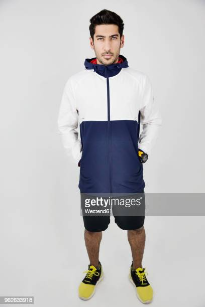 portrait of young man wearing sportswear - hood clothing stock pictures, royalty-free photos & images
