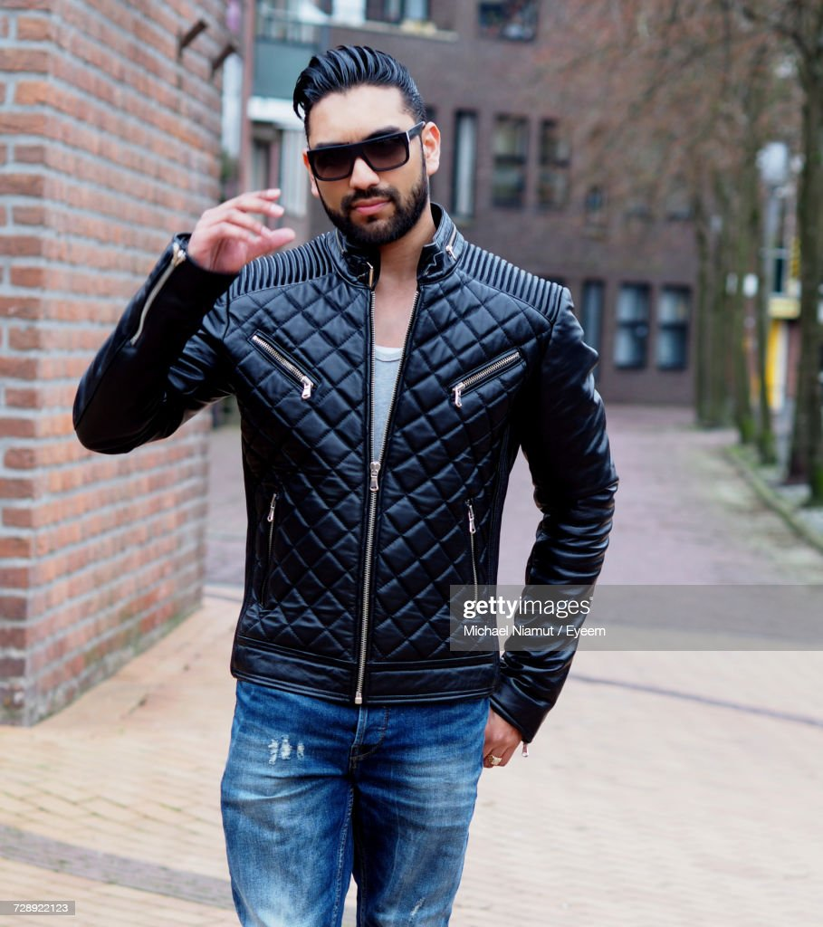 Portrait Of Young Man Wearing Sunglasses And Black Jacket : Stock Photo