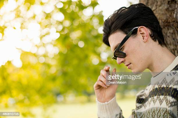 portrait of young man wearing sunglasses - sean malyon stock pictures, royalty-free photos & images