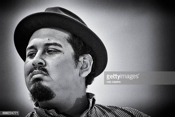 portrait of young man with a hat - rob castro stock pictures, royalty-free photos & images