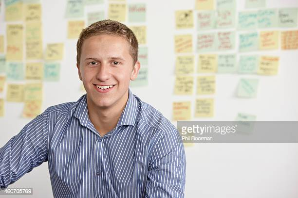 portrait of young man with adhesive notes in background - striped shirt stock pictures, royalty-free photos & images