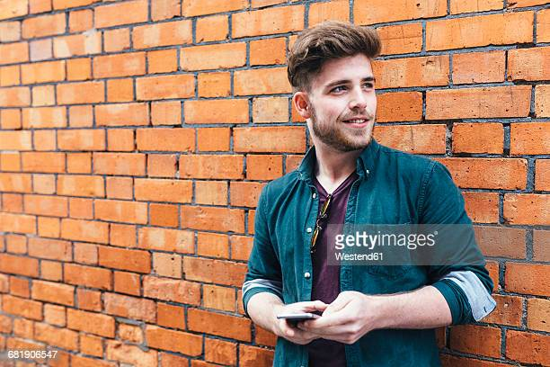 Portrait of young man with cell phone