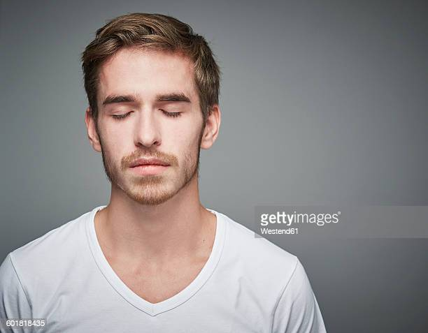Portrait of young man with closed eyes