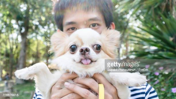 Portrait Of Young Man With Dog