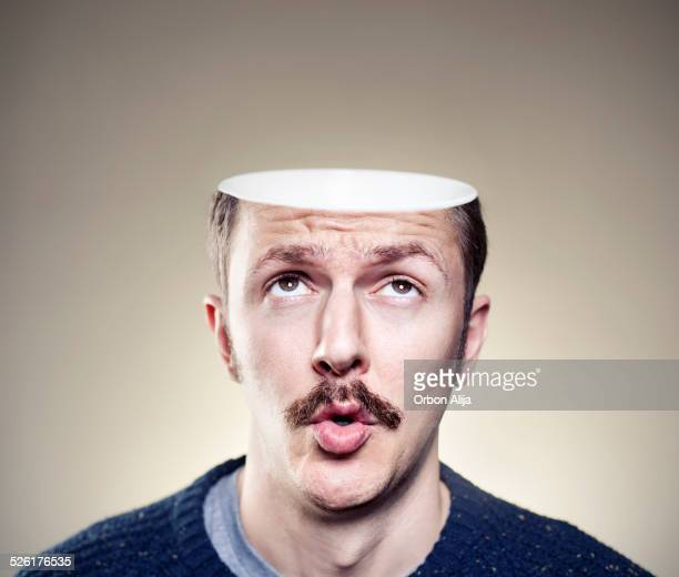 portrait of young man with empty head - hoofd stockfoto's en -beelden