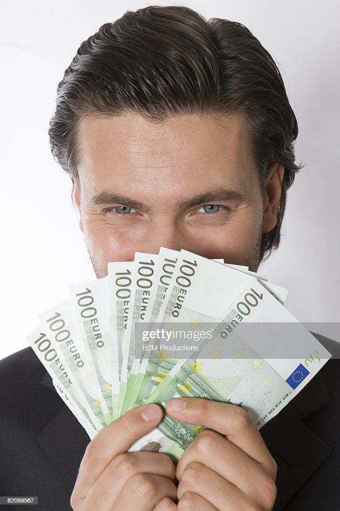 Portrait of young man with Euro banknotes  : Stock Photo