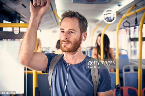 Portrait of young man with headphones in a bus