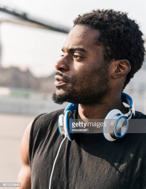 Portrait of young man with headphones outdoors