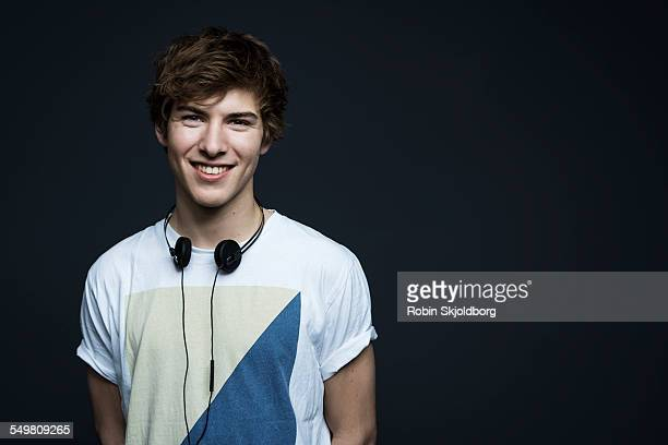 Portrait of young man with headphones smiling