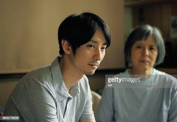 portrait of young man with his mother - japan mom and son stock photos and pictures