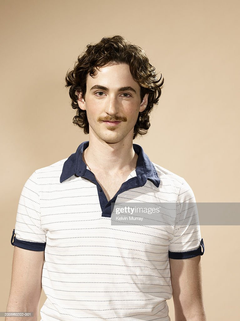 Portrait of young man with moustache : Stock Photo