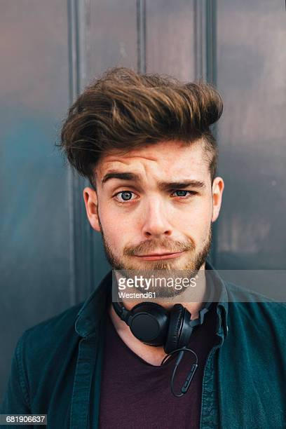 portrait of young man with quiff pulling funny face - ポンパドール ストックフォトと画像