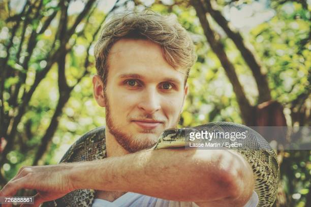 portrait of young man with snake - exotic pets stock pictures, royalty-free photos & images