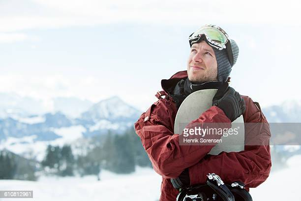 portrait of young man with snowboard