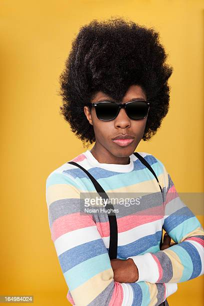 Portrait of young man with styled afro