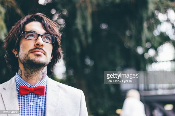 portrait of young man with tattoos - bow tie stock pictures, royalty-free photos & images