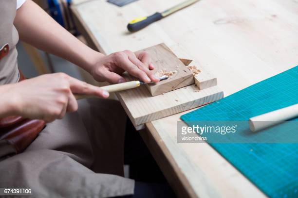 portrait of young man working in a carving workshop - carving craft product stock pictures, royalty-free photos & images