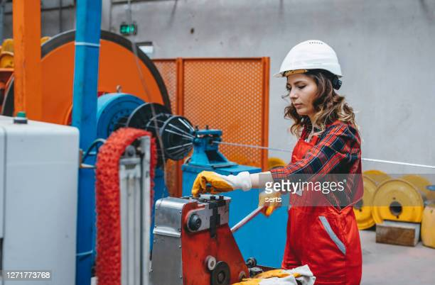 portrait of young manuel worker woman working with ball valves in factory - district heating plant stock pictures, royalty-free photos & images