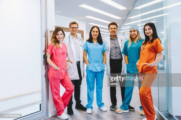 portrait of young medical professionals at hospital - medical student stock pictures, royalty-free photos & images