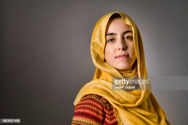 portrait of young middle eastern woman wearing a hijab - headscarf stock pictures, royalty-free photos & images