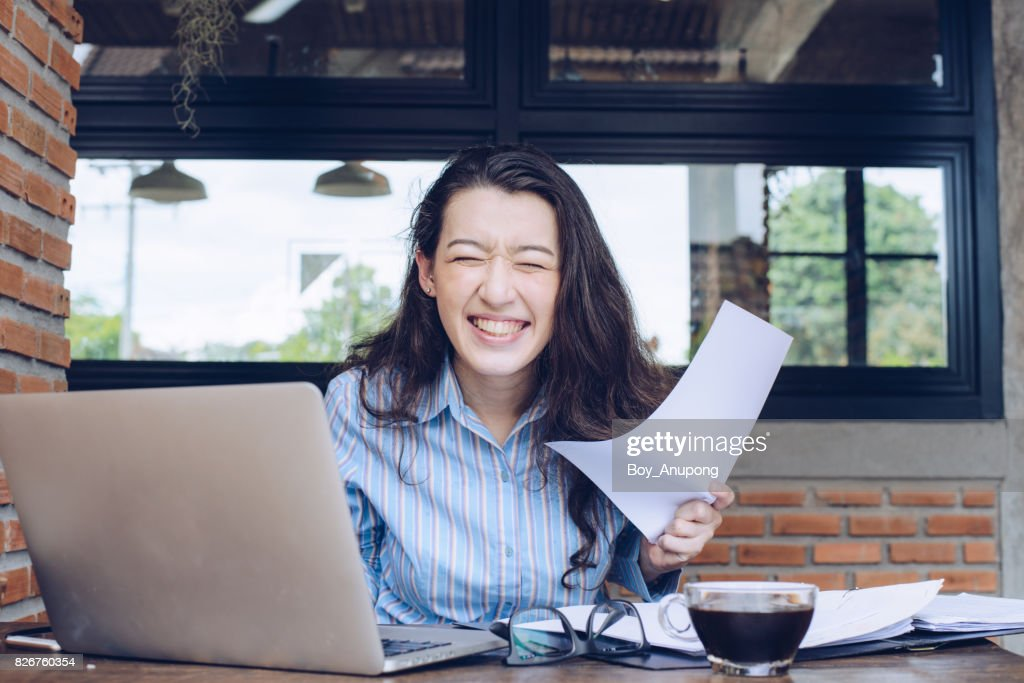 Portrait of young mixed race businesswoman feelings success in her jobs. : Stock Photo