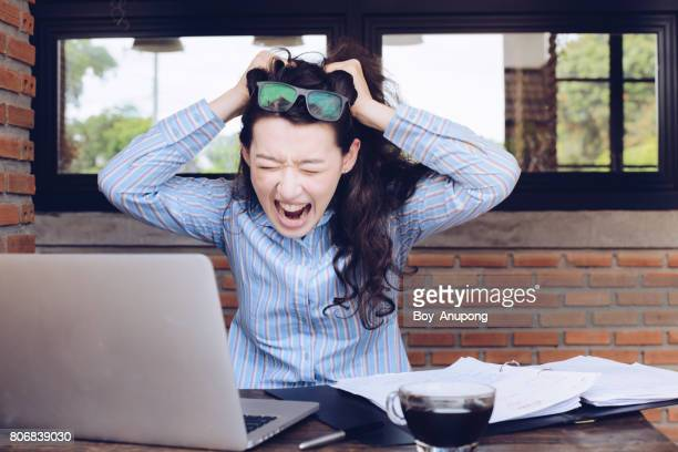 portrait of young mixed race businesswoman feels stress about her jobs. - acting stock pictures, royalty-free photos & images