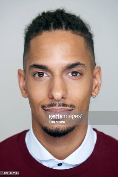 portrait of young mixed race male - ohrring stock-fotos und bilder