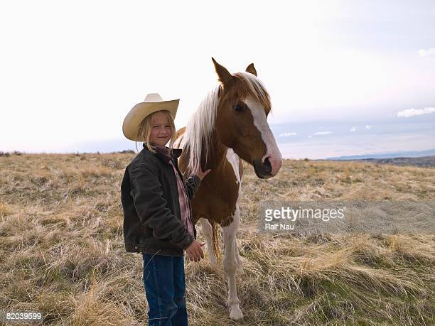 Portrait of young Montana girl with horse