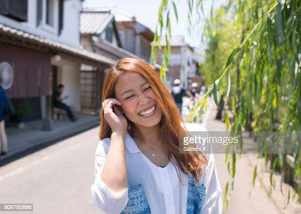 Portrait of young mother smiling in old Japanese town