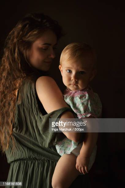 portrait of young mother with her little daughter - daughters of darkness stock pictures, royalty-free photos & images