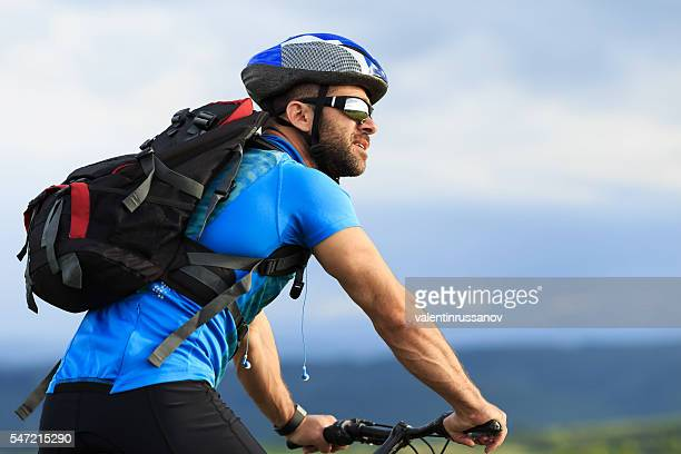 Portrait of young mountainbiker on move