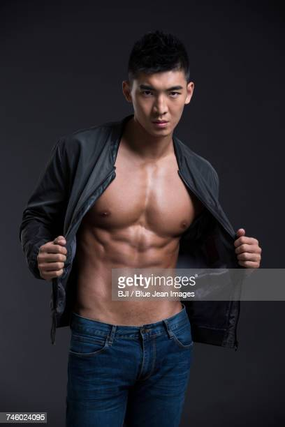 portrait of young muscular man - asian six pack stock photos and pictures
