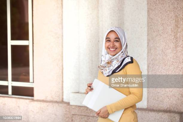 Portrait of young Muslim girl going to class