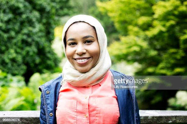 portrait of young muslim woman - modest clothing stock pictures, royalty-free photos & images