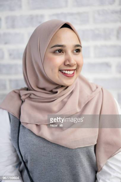 Portrait of young muslim woman with headscarf.