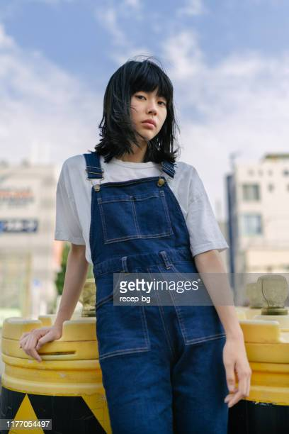 portrait of young natural beauty woman with no make-up - dungarees stock pictures, royalty-free photos & images