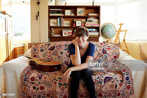 Portrait of young painter sitting in couch at home