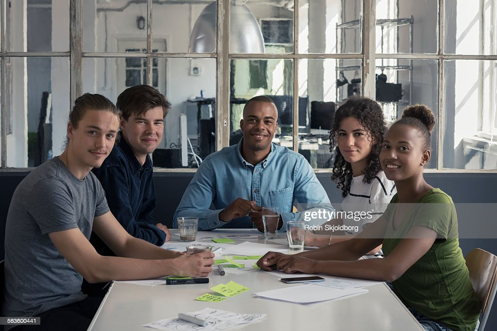 Portrait of young people having meeting : Stock Photo