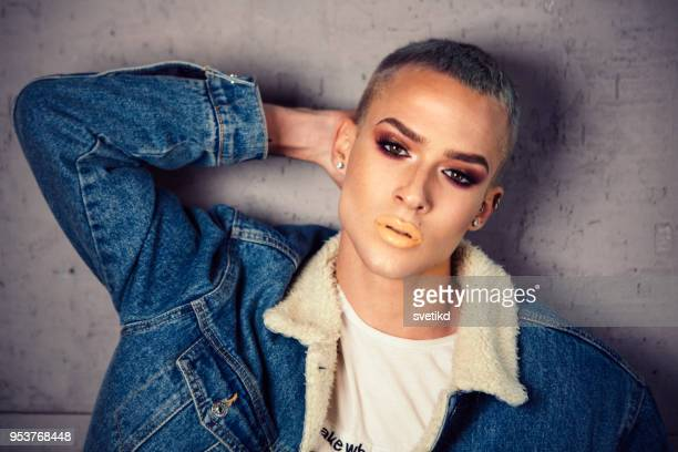 portrait of young person with ambiguous gaze. - gender fluid stock pictures, royalty-free photos & images