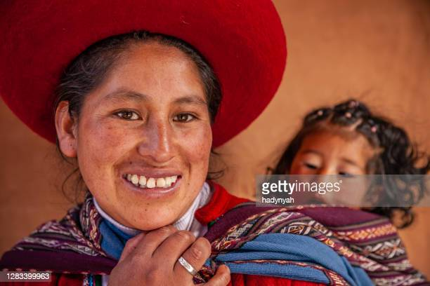 portrait of young peruvian woman mother, the sacred valley, chinchero - quechua people stock pictures, royalty-free photos & images