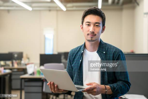 portrait of young professional in modern office - expertise stock pictures, royalty-free photos & images