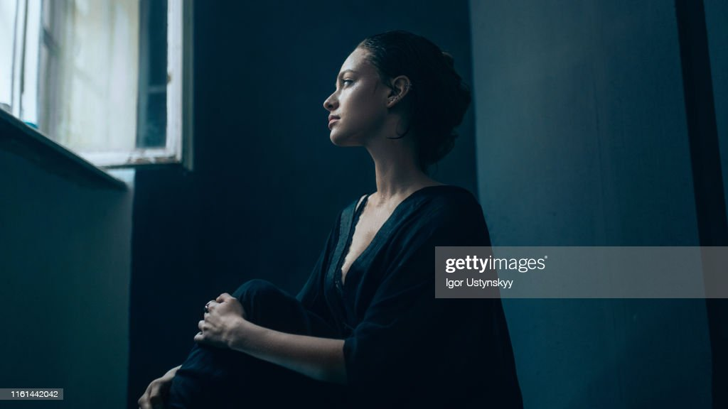 Portrait of young sad woman : Stock Photo
