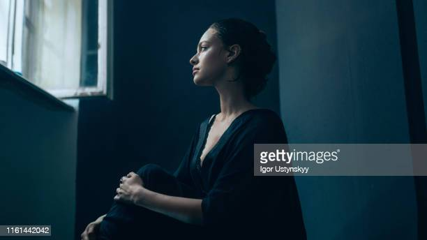 portrait of young sad woman - loneliness stock pictures, royalty-free photos & images