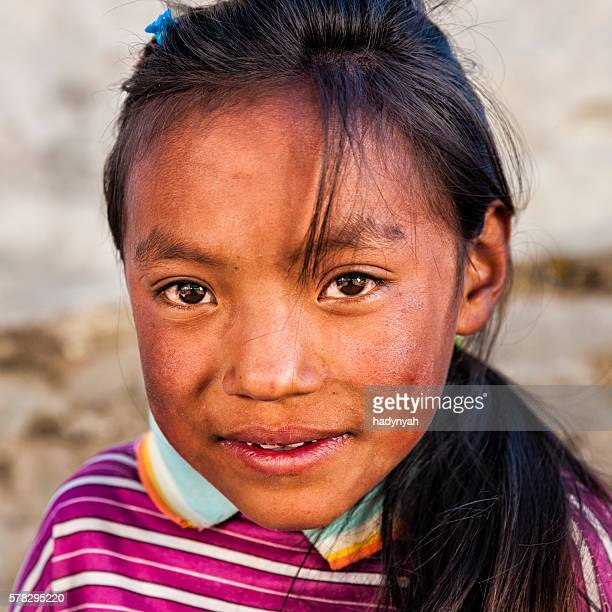 portrait of young sherpa girl in everest region - solu khumbu stock pictures, royalty-free photos & images