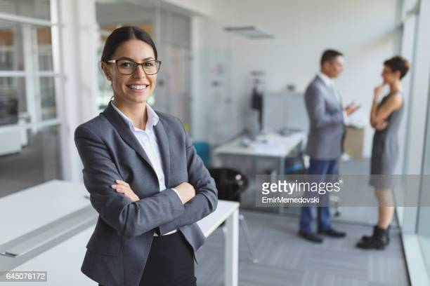 Portrait of young smiling businesswoman in the office.
