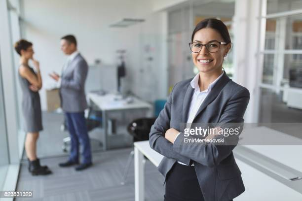 Portrait of young smiling businesswoman in the office