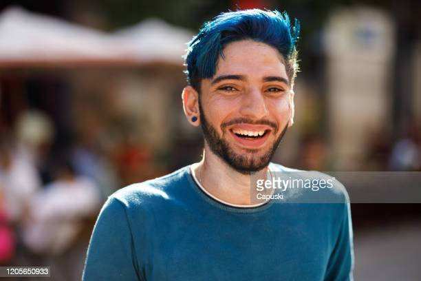 portrait of young smiling man with blue hair - blue hair stock pictures, royalty-free photos & images