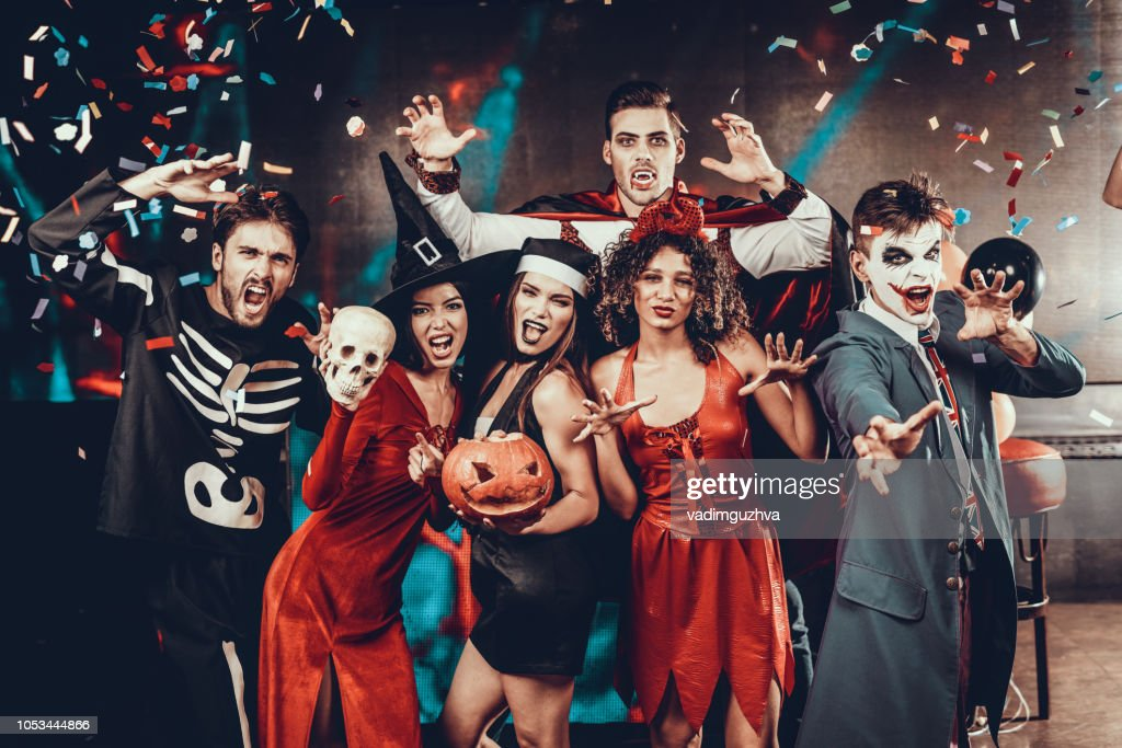 Portrait of Young Smiling People in Scary Costumes : Stock Photo