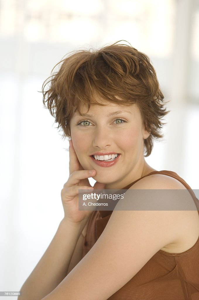 Portrait of young smiling woman : Stock Photo